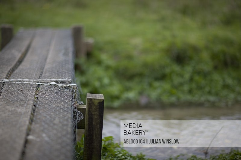 Wooden bridge on a countryside stream