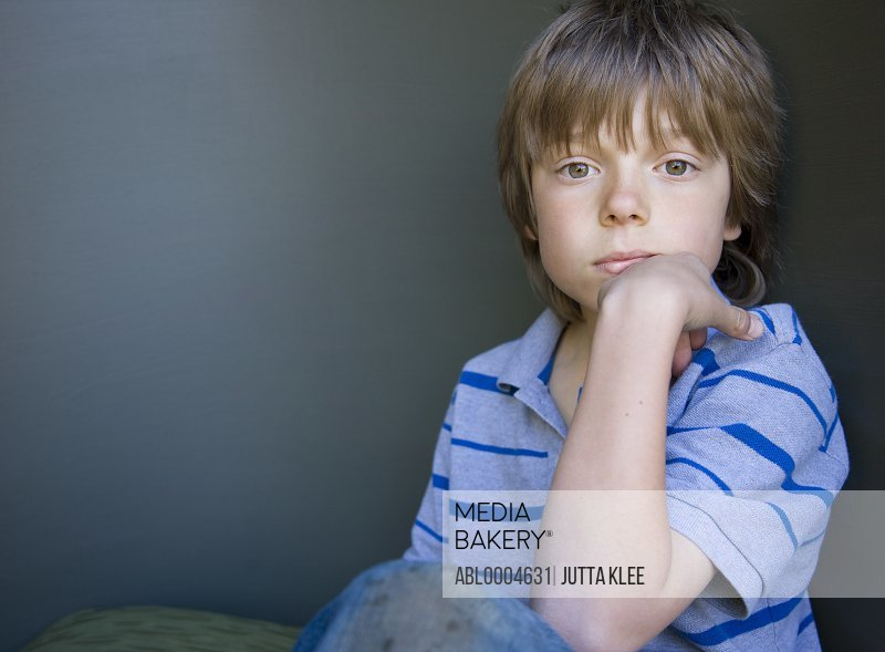Portrait of a boy sitting