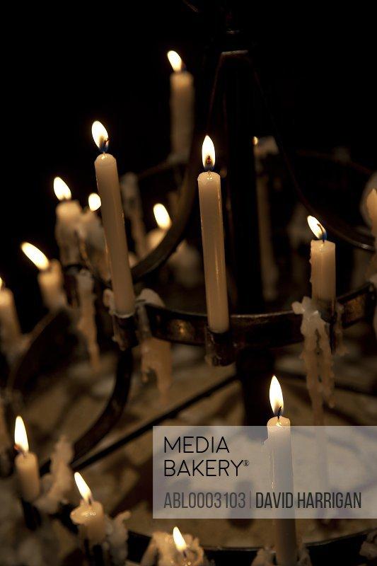 Close up of Burning Candles on Candelabra