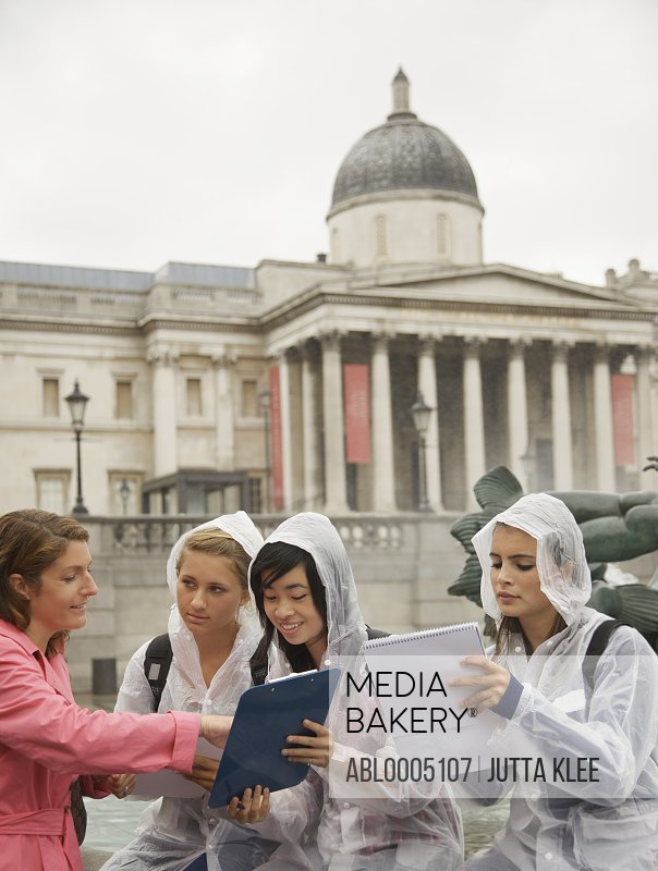 Teacher and Students in Trafalgar Square, London, England