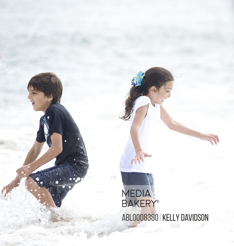 Boy and Girl Playing in Sea Water