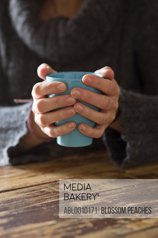 Woman's Hands Holding Coffee Cup