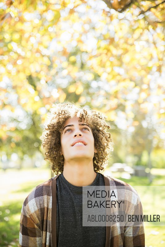 Young Man in Park in Autumn