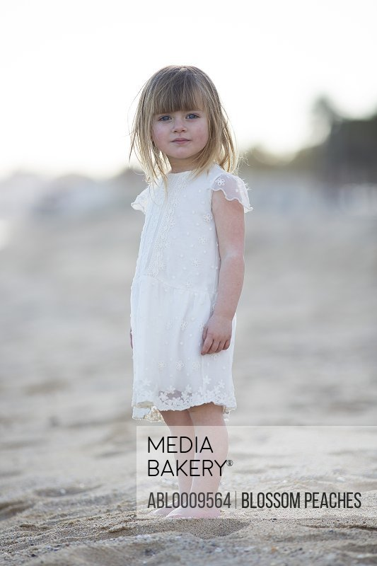 Young Girl Wearing White Dress on Beach