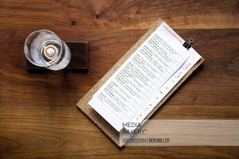 Menu and Candleholder on Wooden Table