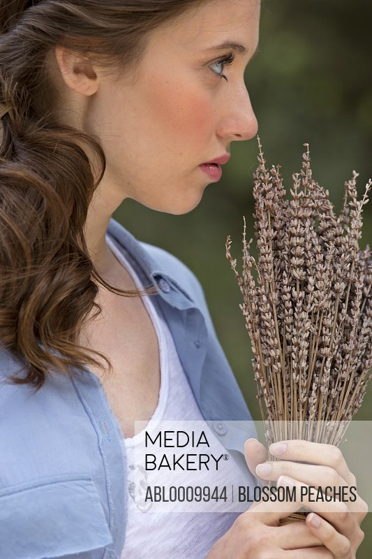 Young Woman Holding a Bunch of Dried Lavender