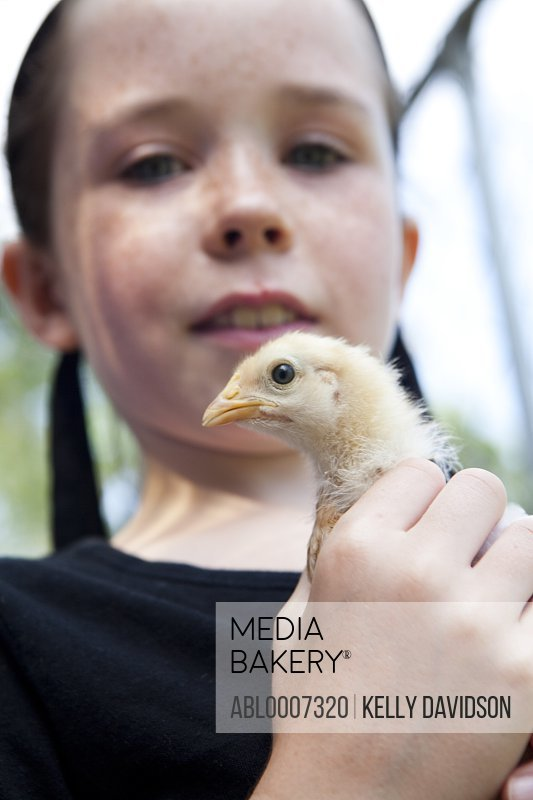 Girl Holding Chick