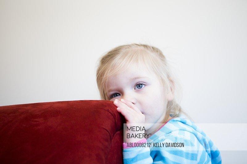 Girl Leaning on Corner of Sofa
