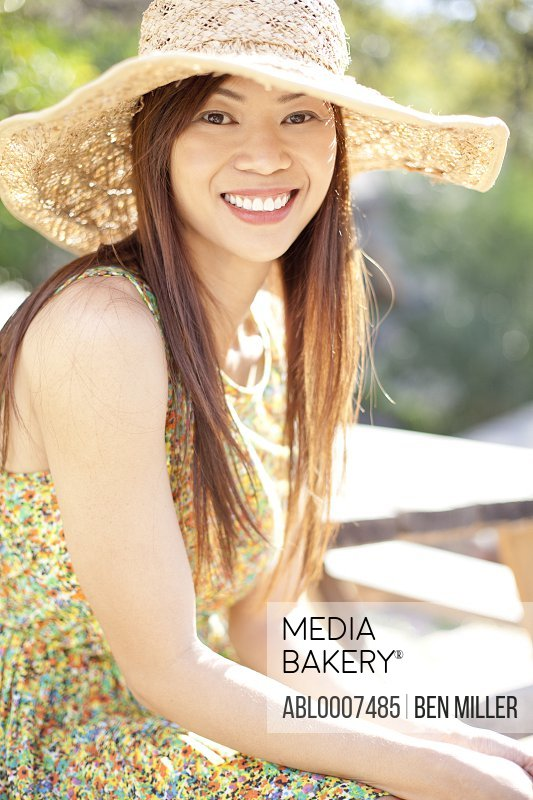 Smiling Woman Wearing Straw Hat
