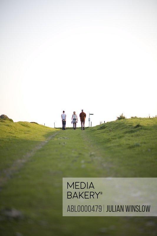 People walking on public footpath in countryside