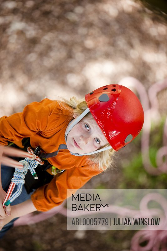 Young girl dangling from a rope - high angle