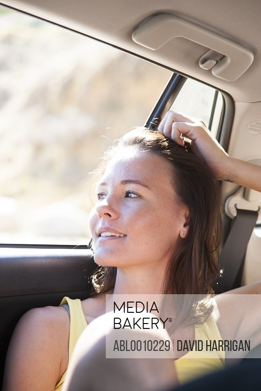 Woman in Car Back Seat Smiling