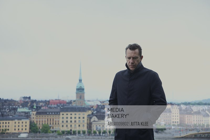 Portrait of Man with Stockholm Cityscape in Background