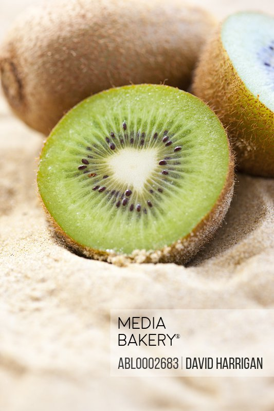 Kiwi Fruit in Beach Sand, Close up view