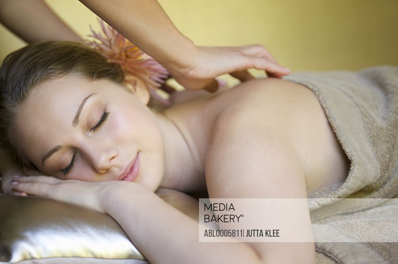 Young woman receiving a back massage