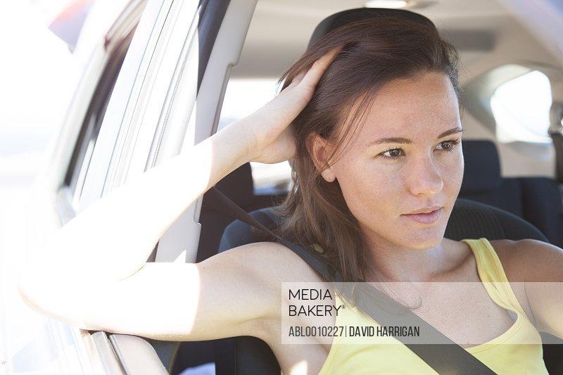 Young Woman Inside Car Wearing Seat Belt