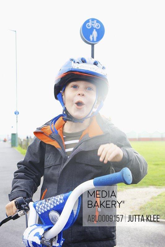 Boy Wearing Helmet Riding Bike