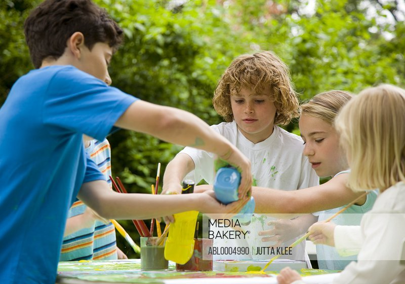 Children Painting in Garden