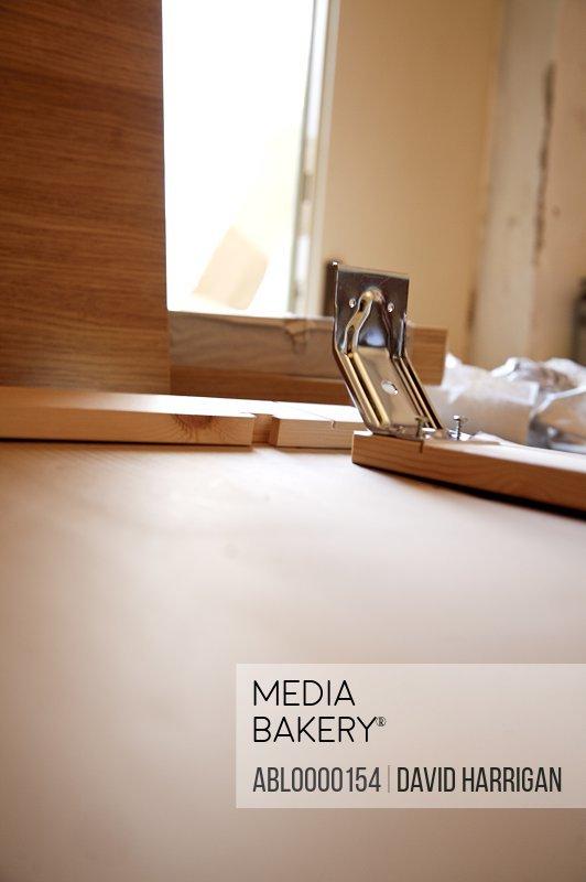 Flat pack furniture DIY with metal bracket