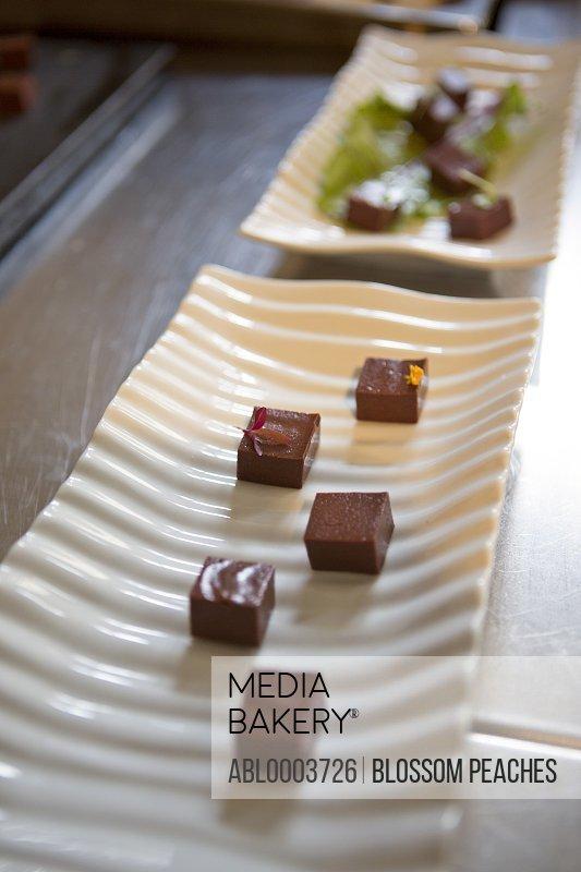 Chocolate Pralines on White Platter
