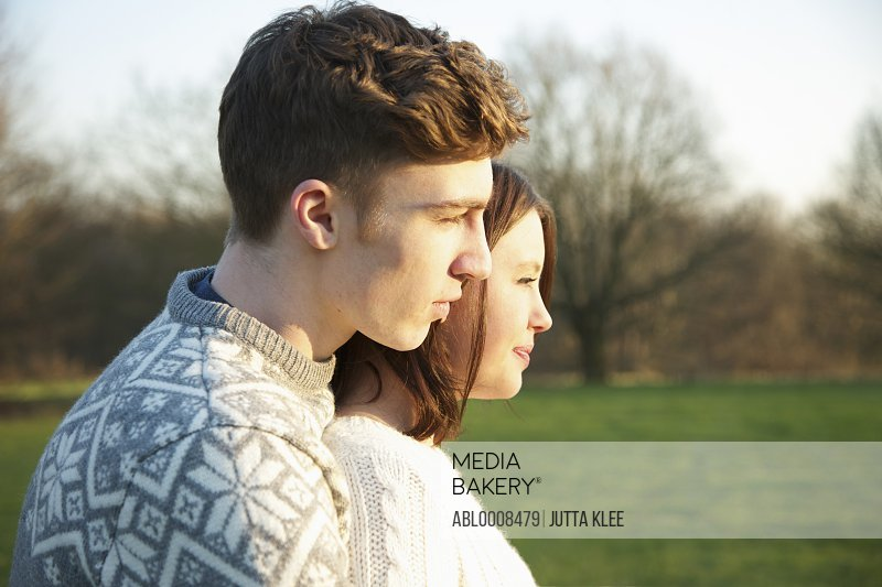 Profile of Young Couple in Park