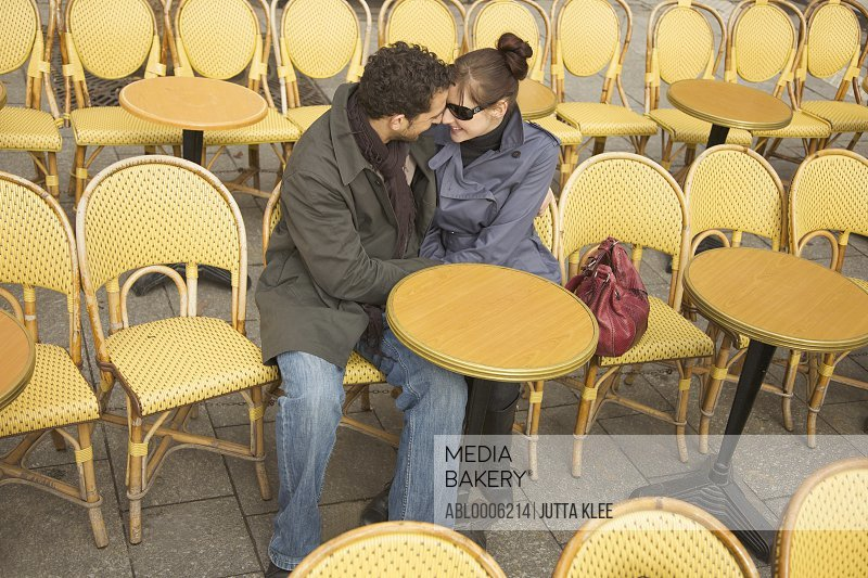 Young couple at outdoor cafe, Paris, France