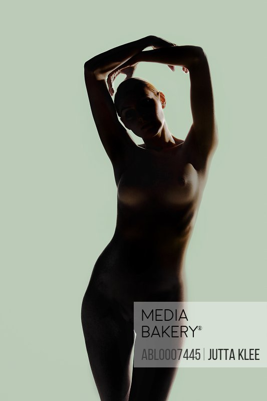 Silhouette of Nude Woman with Arms above head