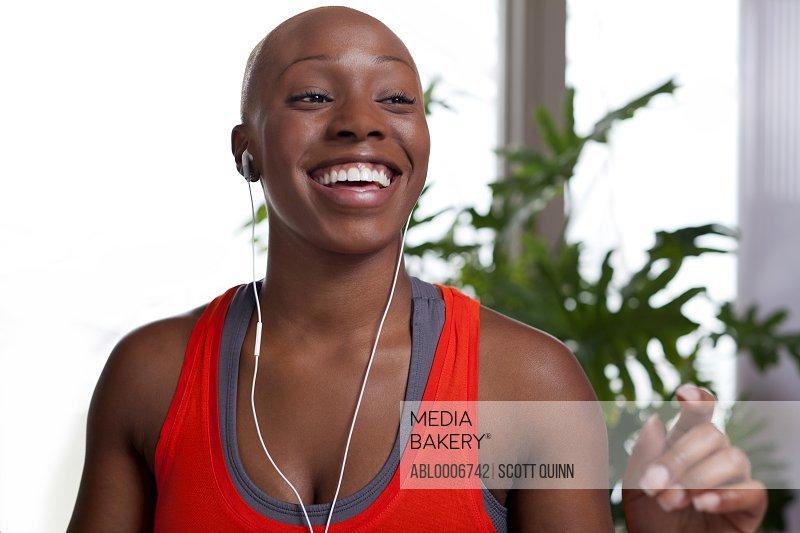 Smiling Woman Wearing Earphones