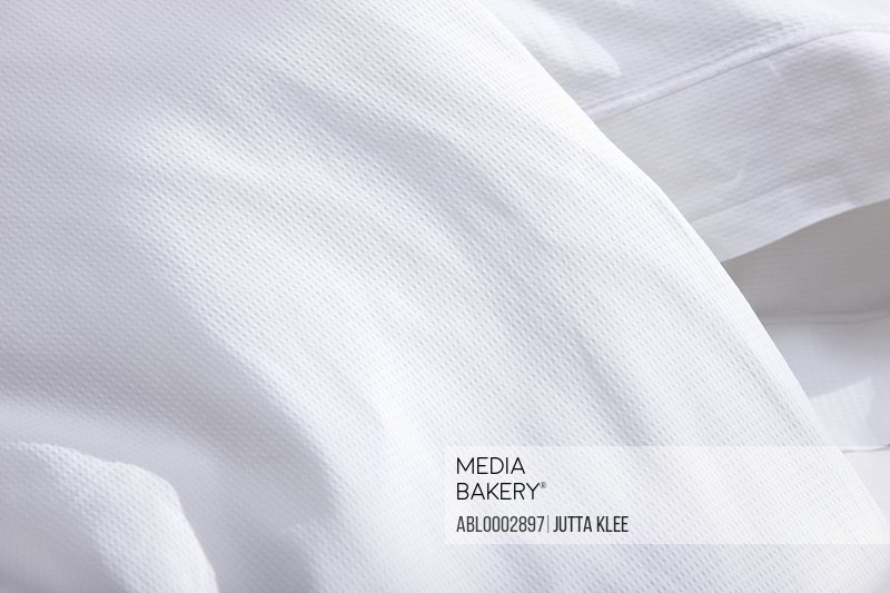 Detail of White Bed Cover and Pillowcase