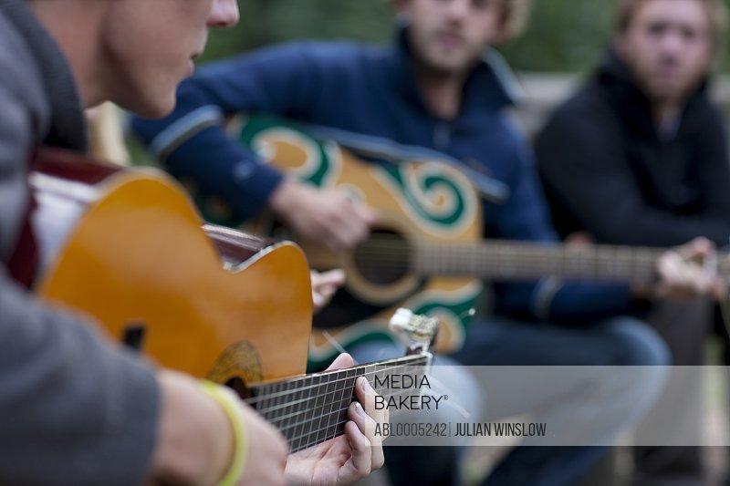 Men Playing Acoustic Guitars