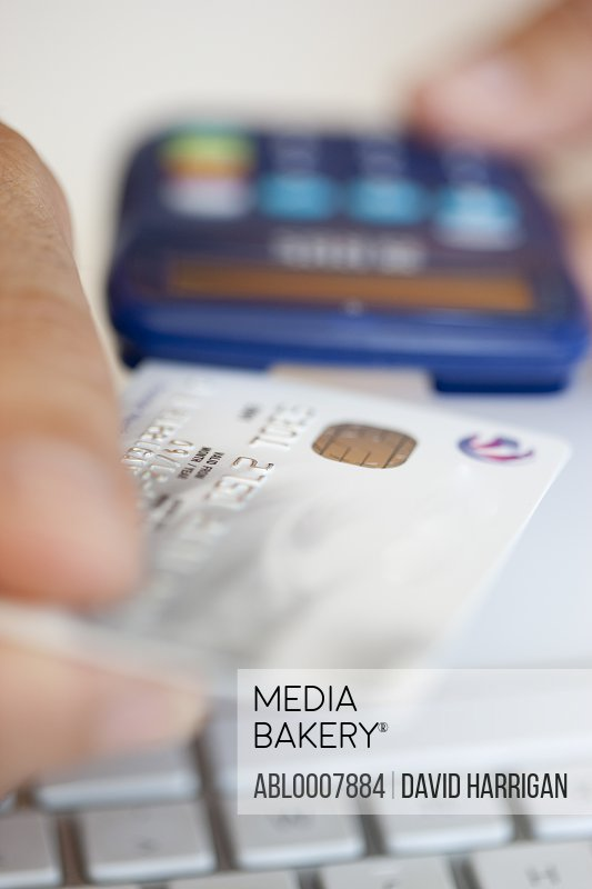 Man Inserting Credit Card into a Card Reader