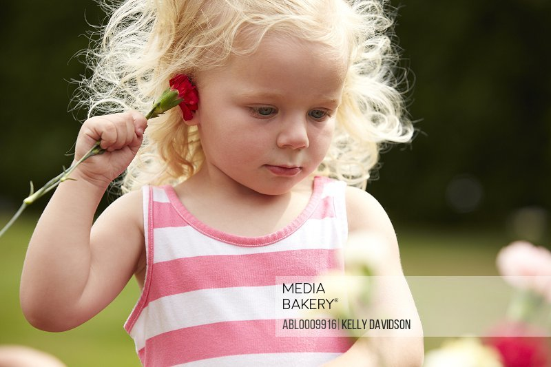 Young Girl Holding Red Carnation