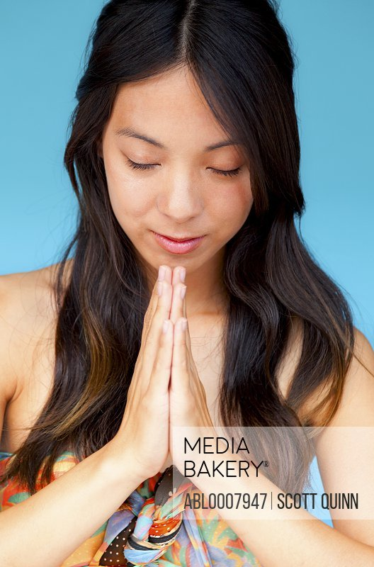 Young Woman with Hands in the Prayer Position