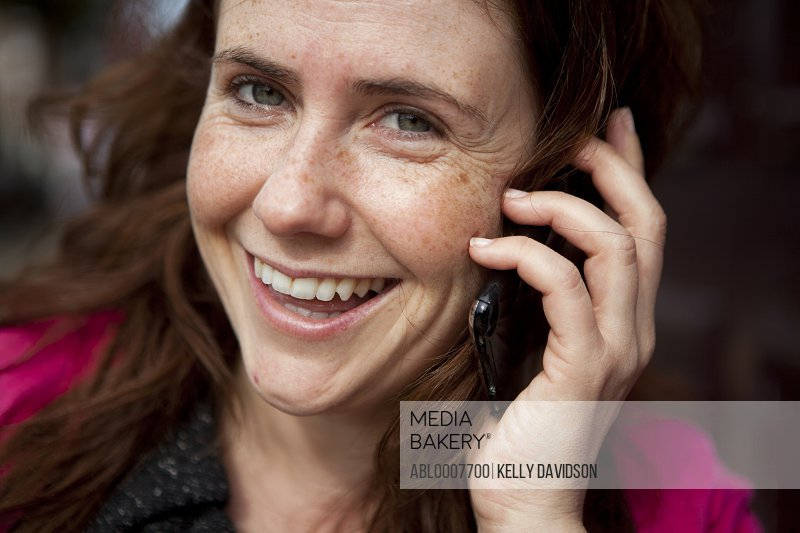 Smiling Woman Using Cell Phone