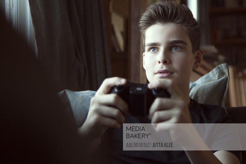 Teenage Boy Playing Video Game