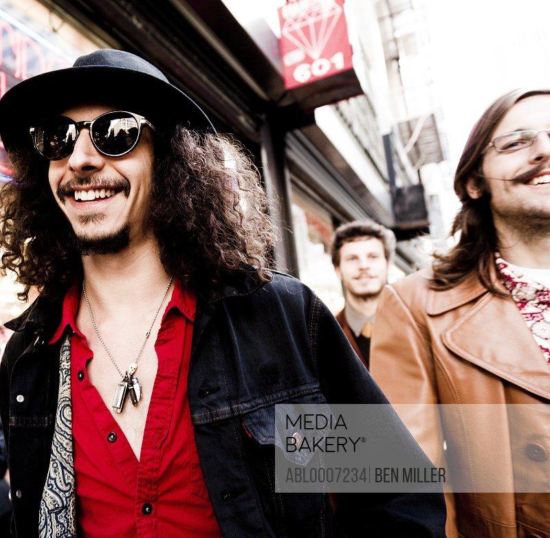 Smiling Men Walking on City Street