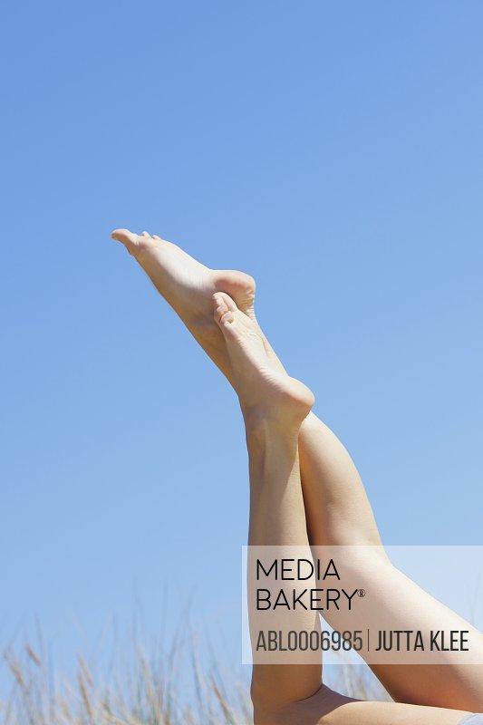 Woman's Legs against Blue Sky