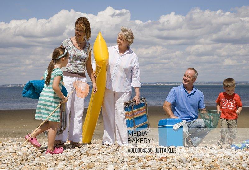 Portrait of multigenerational family leaving beach