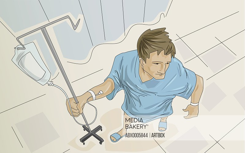 Male patient holding an iv drip stand