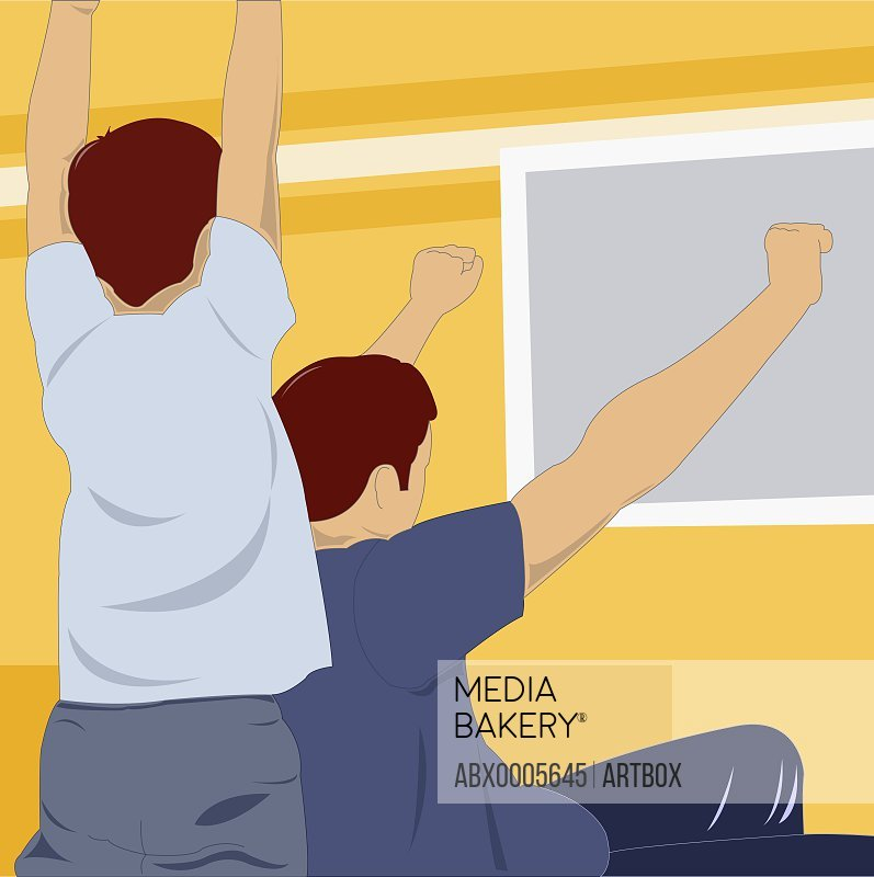 Man and a boy cheering