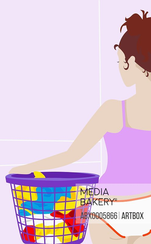 Young woman holding a laundry basket