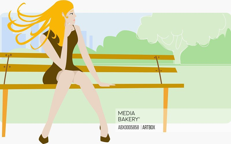 Young woman sitting on the bench and looking away
