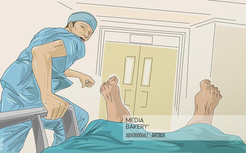 Male doctor running with a patient on the bed