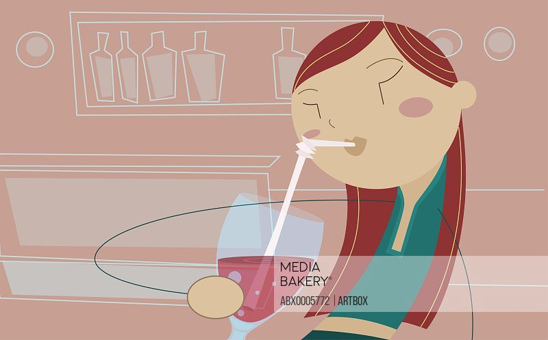 Woman drinking with a straw
