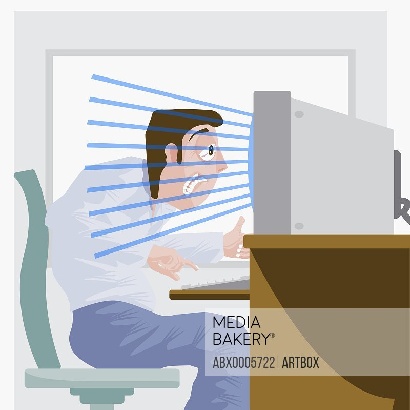 Man sitting at computer with radiation emitting from it