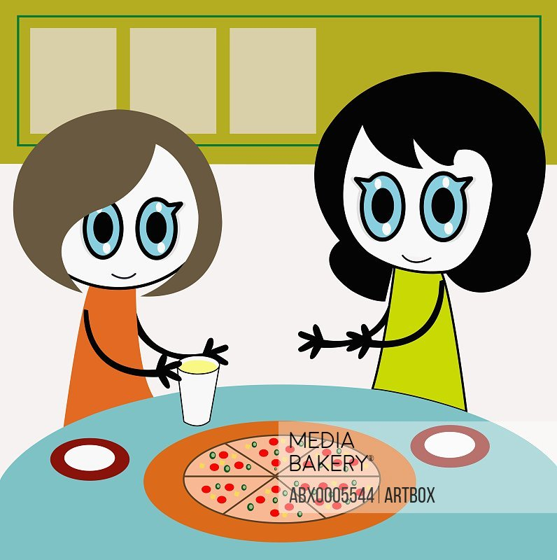 Two girls at a table with a pizza
