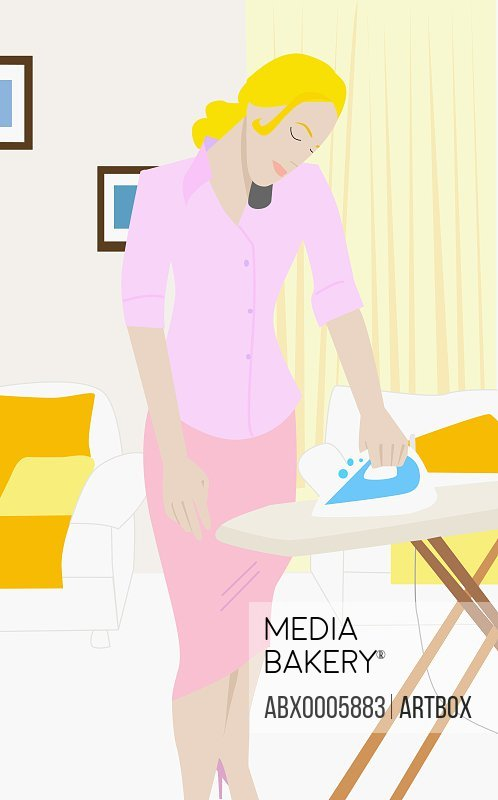 Young woman ironing and using a mobile phone