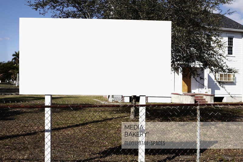 Blank Billboard on a Lawn