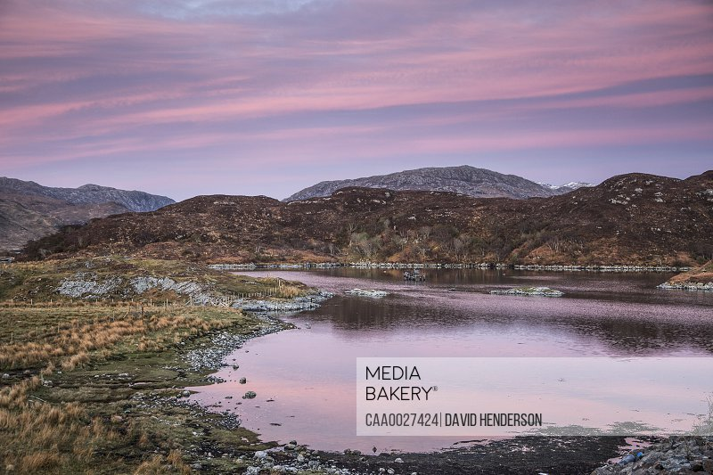Pink sunrise sky over Badcall Bay, Sutherland, Scotland