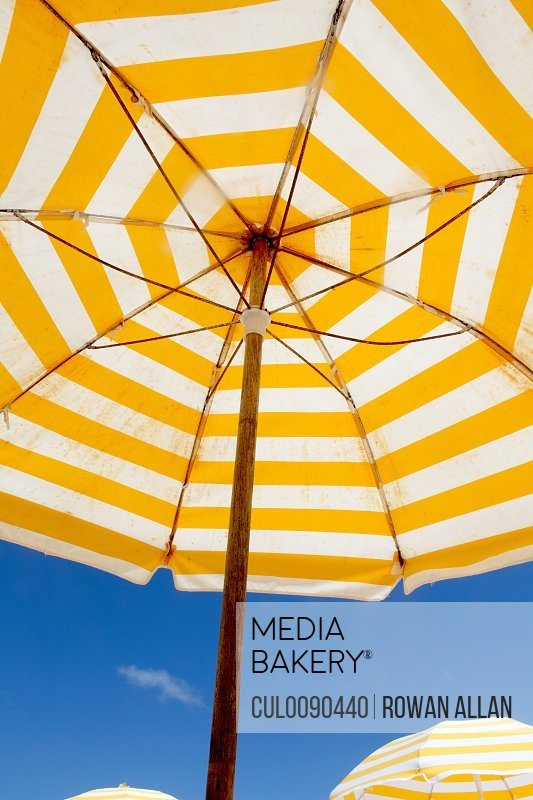 Striped umbrella under blue sky